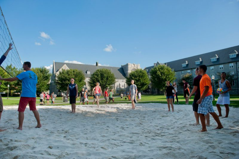 Students play volleyball in the Eggleston Quad