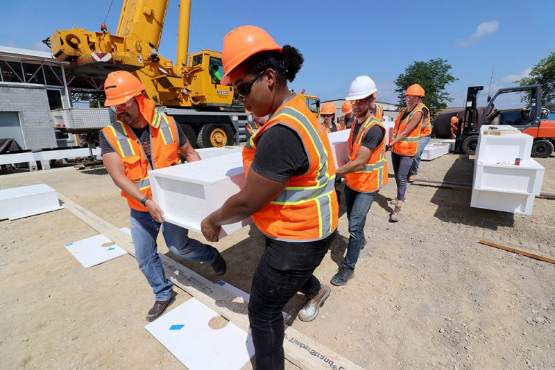 Students work on a construction project